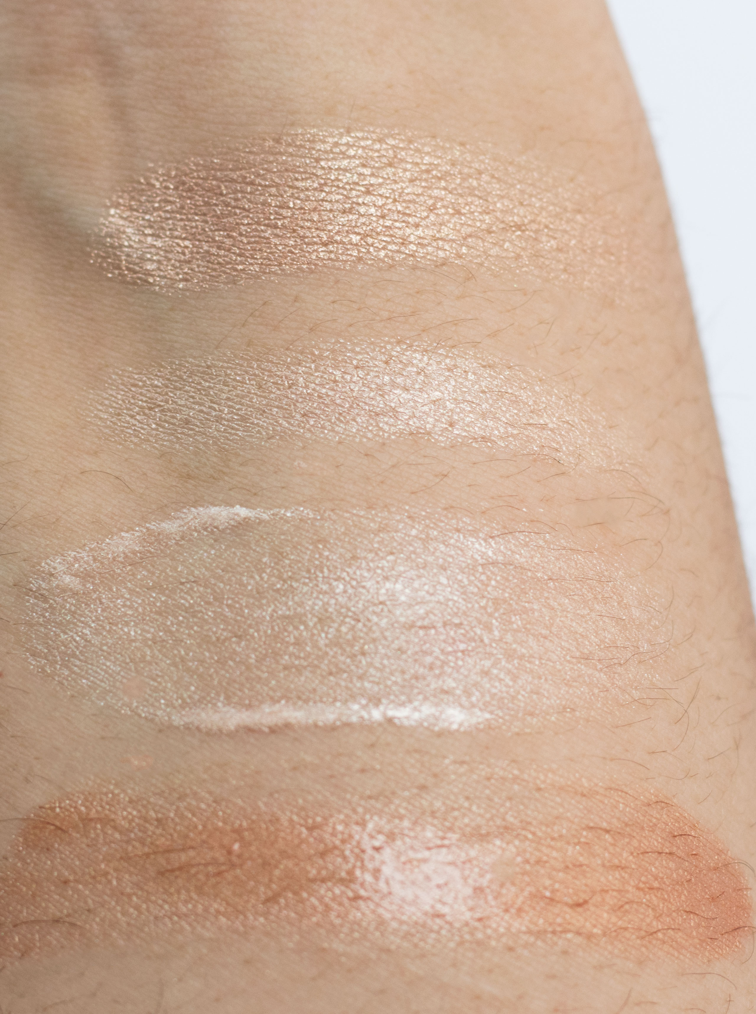 top to bottom: Burberry Fresh Glow Rose Gold, Burberry Fresh Glow Highlighting Luminous Pen, Burberry Fresh Glow Luminous Base No 1 Nude Radiance and No 2 Golden Radiance