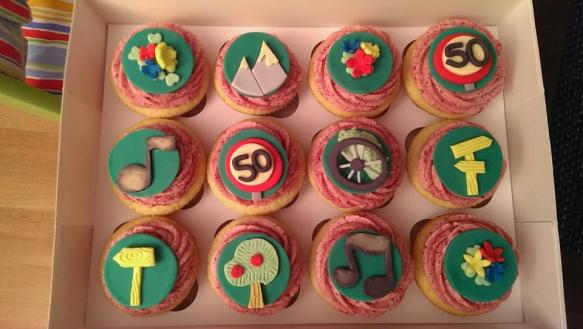 Matching cupcakes to the 50th birthday cake