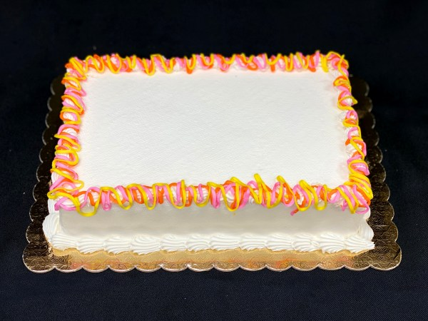 Frosted cake with scalloped edge
