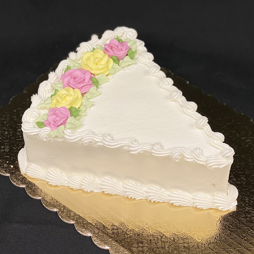 Frosted wedge cake with buttercream flowers