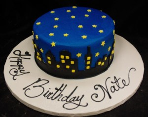 Blue cake with cityscape decorations