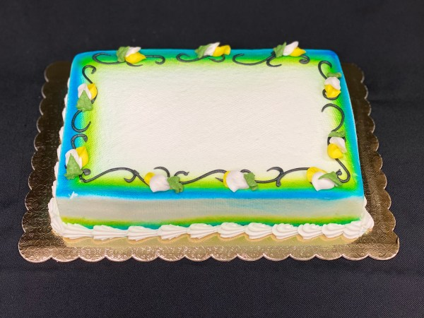 Frosted rectangle cake with intertwined vines and flowers