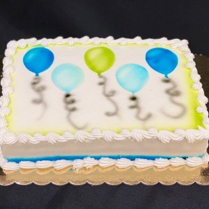 Rectangle frosted cake with air-brushed balloons
