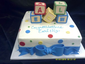 White fondant with sculpted blocks and bow