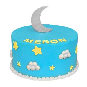 a blue butte cream cake with stars and clouds