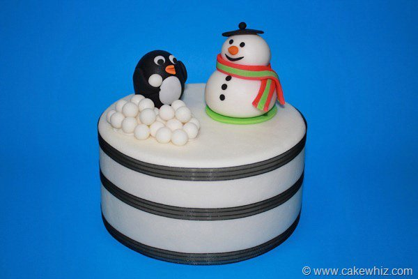 Winter Cake With Fondant Snowman Topper and Fondant Penguin Topper