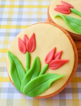 Easy Homemade Tulip Cookies Placed on a Checkered Background