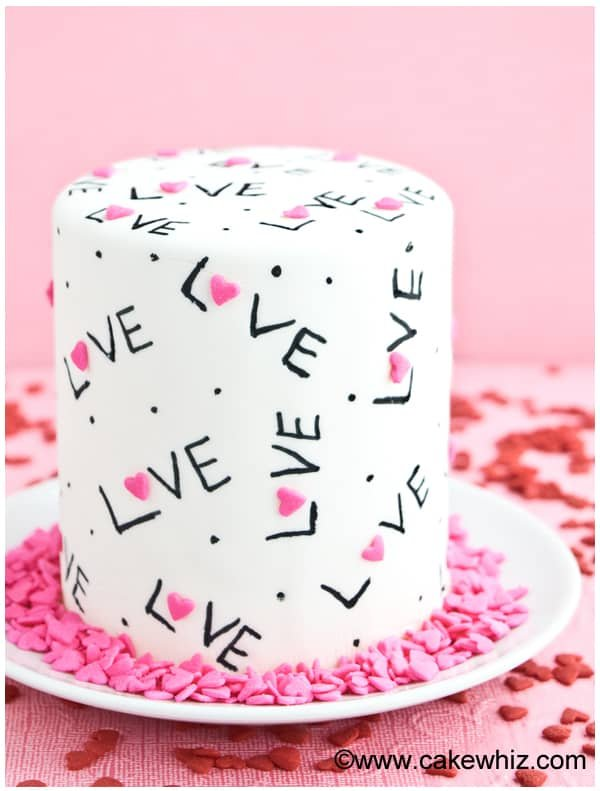 Easy Decorated Love Cake Design on White Plate with Pink Background