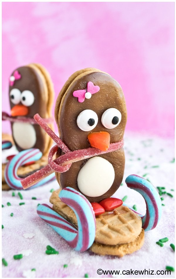 Easy Penguin Cookies on Pink Background