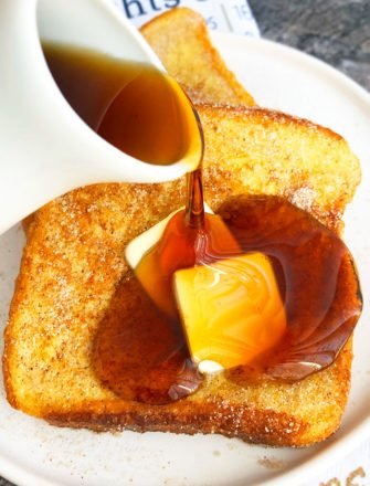 Cinnamon French Toast with Syrup Being Poured