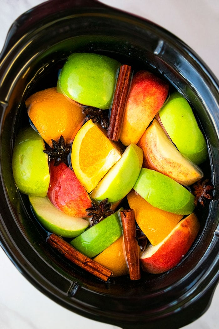 Mulled Cider Ingredients in Black Slow Cooker
