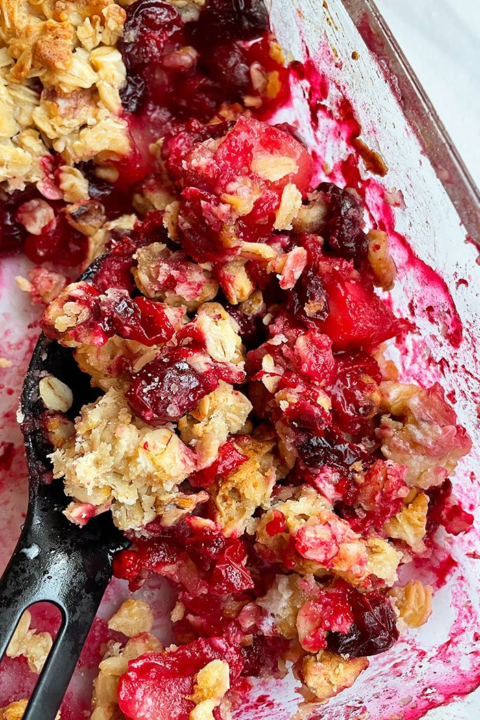 Spoonful of Cranberry Crumble in Glass Dish- Closeup Shot