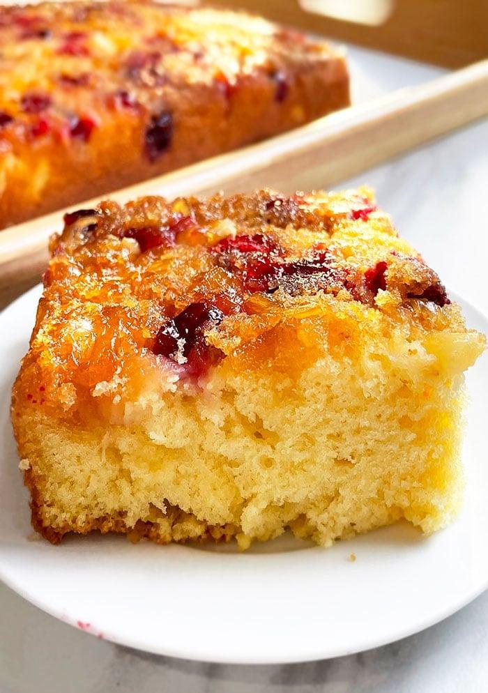 Slice of Cranberry Orange Upside Down Cake on White Plate