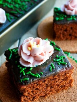 Chocolate Cake Decorated with Pink Royal Icing Flowers and Green Sprinkles