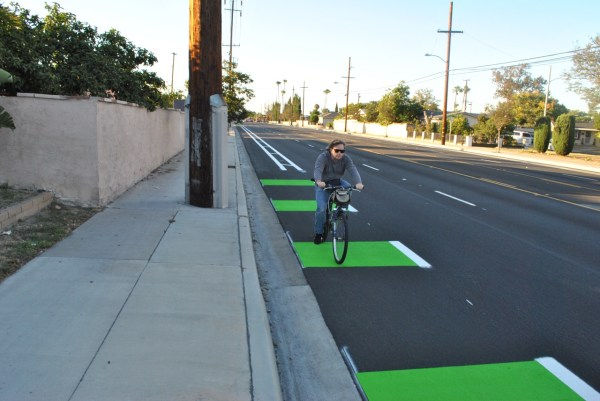 A bicyclist riding southbound on the newly painted New Hope Street bike lane. The roughly one-mile bike lane stretches from West Westminster Avenue to West Fifth Street in Santa Ana.