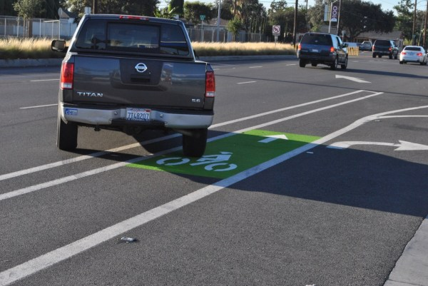 A truck crossing the northbound Bristol Street bike lane where a newly painted green strip was placed late last month.