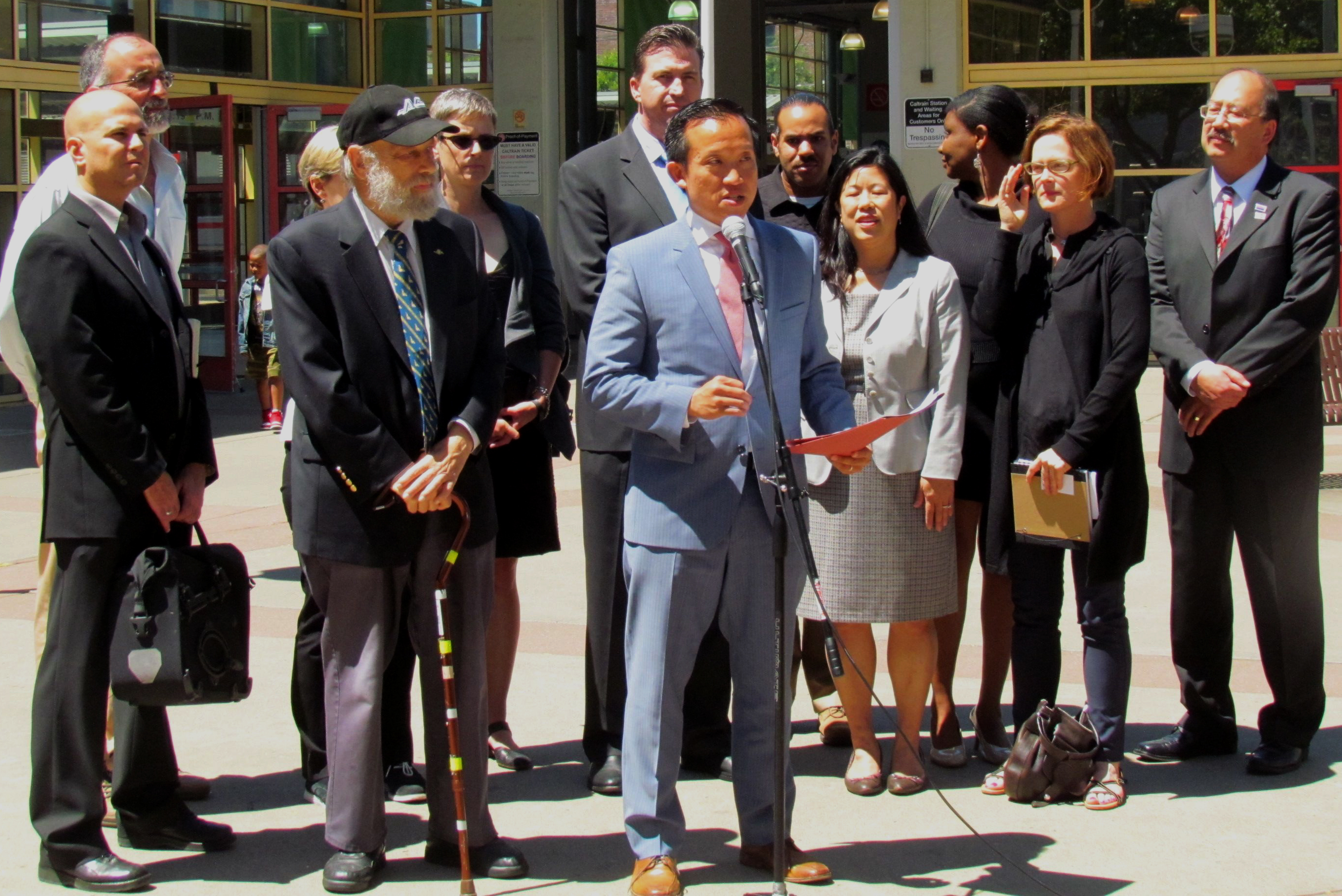 Assemblymember David Chiu proposes a packet of bills to fund transit, flanked by representatives from local transit agencies and advocates. Assemblymember Kevin Mullin is behind him. Photo: Melanie Curry/Streetsblog