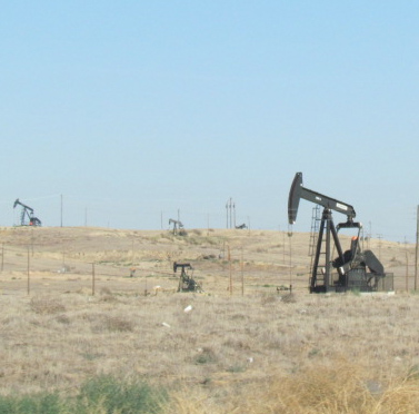 The California Air Resources Board says that the cap-and-trade program is a success. Next year's report will include the transportation and fuels sector. Image: Oil fields near Bakersfield. Melanie Curry.
