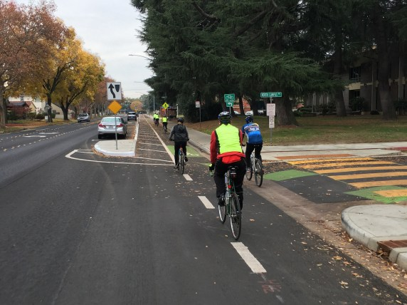 Riders enter the new parking-protected bike lane along XX Ave. Photo: Michael Sacuskie