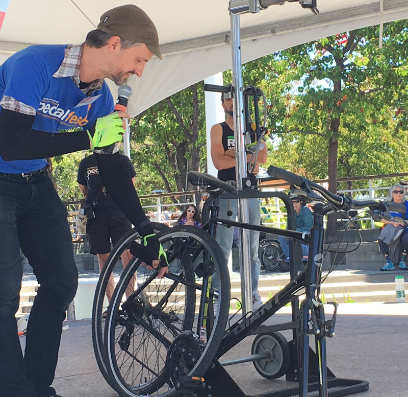 Bike East Bay's Robert Prinz grades a contestant's bike locking skills.