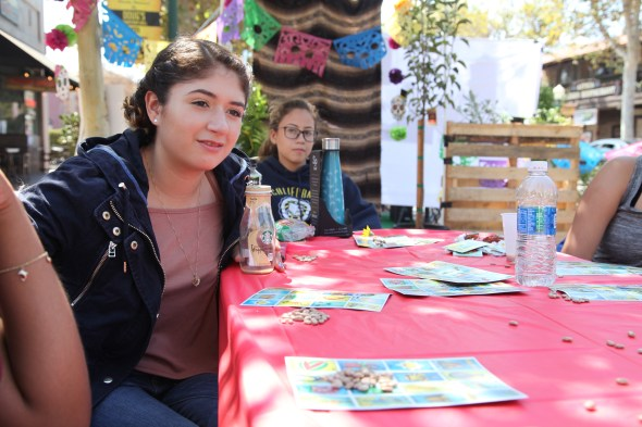 Anaheim High School students play loteria during Orange County's (Park)ing Day. Photo by Kristopher Fortin