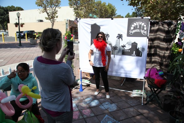 Michele Martinez, right, posing at the Santa Ana photo booth during Saturday's (Park)ing Day event. Photo by Kristopher Fortin