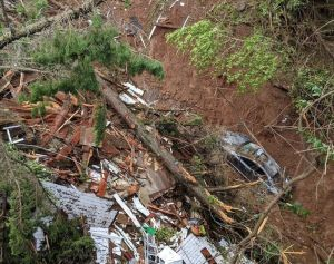 Sausalito landslide showing damage to car and structure