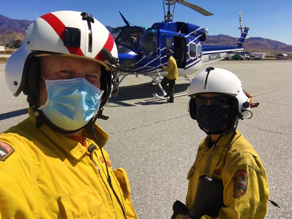 Two California Geological Survey staff take a photo before boarding a helicopter to complete a post fire analysis of the Apple Fire.