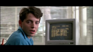 Ferris Bueller sitting in front of his monochrome amber monitor.