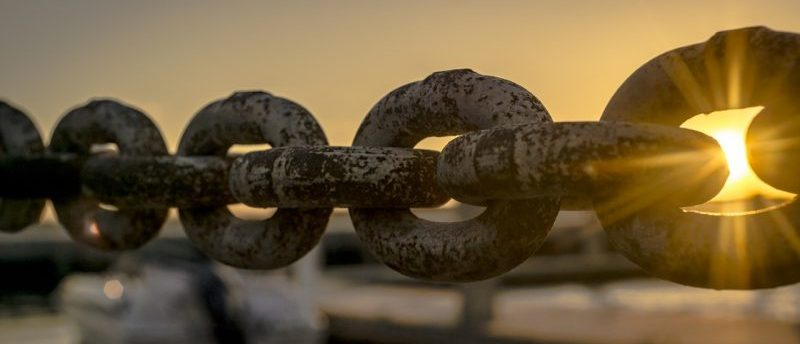 A long chain stretched across a lake.