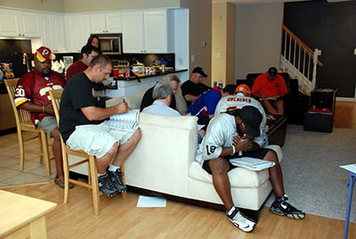 Every fantasy football season starts out with a room full of friends catching up on old times and drafting a team full of player, which they will cheer for all season long. Photo courtesy of David Clow-flickr