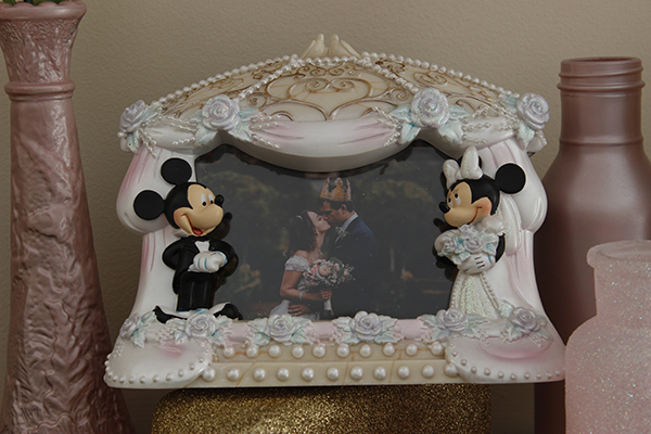Makenna Lewellyn's wedding photo, taken at Hatley Castle last year, sits on her banister framed forever in a Mickey and Minnie wedding frame.  Photo by Mackenzie Jaquish.