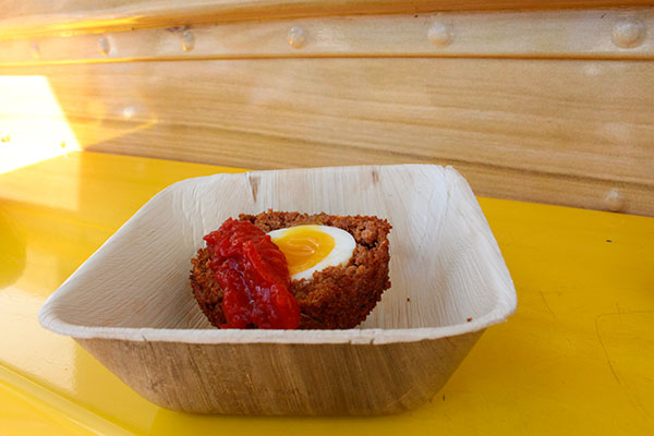 The Crack'd food truck features a scotch egg, which features house-made chorizo wrapped around a soft boiled egg, then breaded and deep fried, topped with a sweet red pepper and tomato relish. Photo by Casey Richardson.