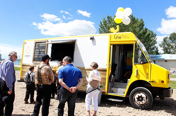 The Crack'd food truck sits outside the Hutterite colony near Fairview on June 27, allowing the Hutterites, who are major egg producers, to taste the menu created by chef Henkel. Photo by Casey Richardson.