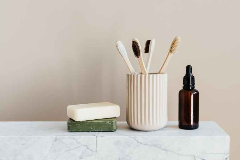 set of natural nonpolluting toiletries on marble table
