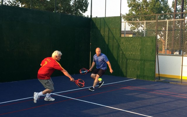 Teamwork in padel, covering the center