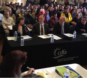 CDFA Secretary Karen Ross (left) speaking about the drought today at a meeting of the California State Board of Food Agriculture. To Secretary Ross' left are Dr. Mark Starr of the California Department of Public Health, Secretary John Laird of the California Natural Resources Agency, and Mark Ghilarducci, Director of the Governor's Office of Emergency Services.