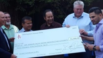 Boxing Champ Jose Ramirez presents a check to the SJVWIA