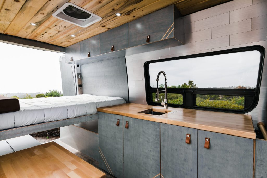 Camper van kitchen, overhead cabinets, maxxfan and tongue in groove ceiling.