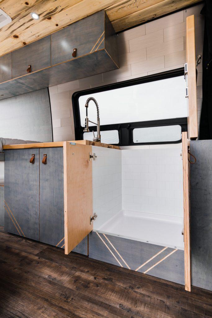 Camper van with hidden shower.