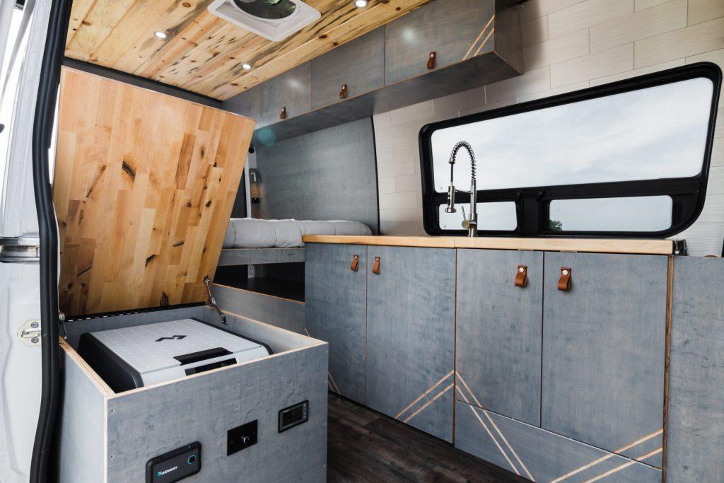 Mercedes Sprinter custom camper van with kitchen, Dometic CFX3 45 refrigerator and shower..