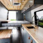 Mercedes Sprinter custom camper van kitchen and bed.