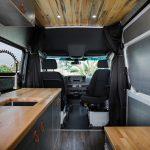 Mercedes Sprinter conversion van kitchen and passenger swivel base.