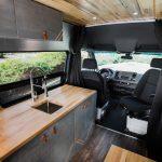 Mercedes Sprinter camper van kitchen and swivel seat.