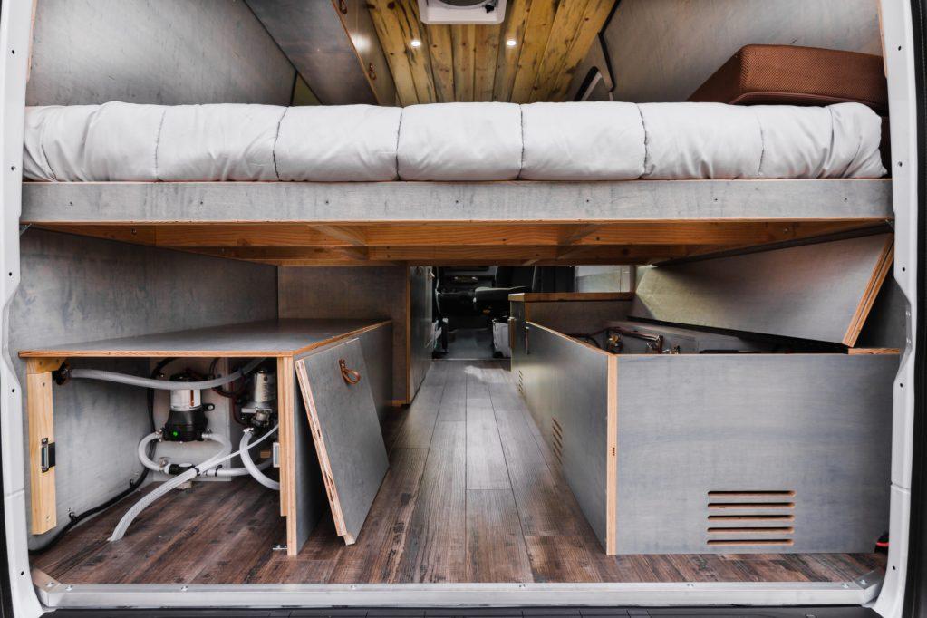 Custom built camper van platform bed, storage, plumbing and electrical system.