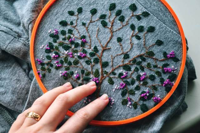 an embroidered tree design in a hoop
