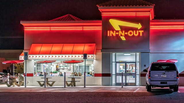 The neon-lit front of an In N Out restaurant in California