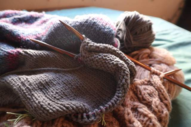 a bundle of knitting with needles and yarn