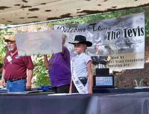 Mary Homicz CSHA Region 18 Little 1st Princess Pulling the winning ticket for the stained glass