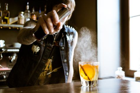 CBD Bartender pouring a cannabis drink at the bar